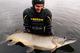 В Днепре подводный охотник поймал щуку, заглотившую сома